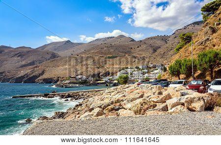 Rocky coastline landscape of Sfakia town harbour on Crete island