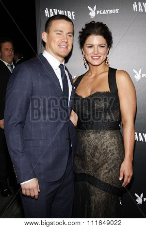 HOLLYWOOD, CALIFORNIA - January 5, 2012. Channing Tatum and Gina Carano at the Los Angeles premiere of