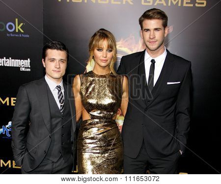 LOS ANGELES, CALIFORNIA - March 12, 2012. Josh Hutcherson, Jennifer Lawrence and Liam Hemsworth at the Los Angeles premiere of