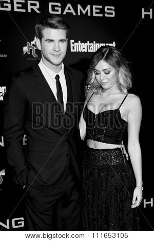 LOS ANGELES, CALIFORNIA - March 12, 2012. Liam Hemsworth and Miley Cyrus at the Los Angeles premiere of