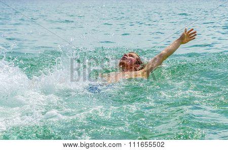 Handsome Teen Backstroking In The Ocean