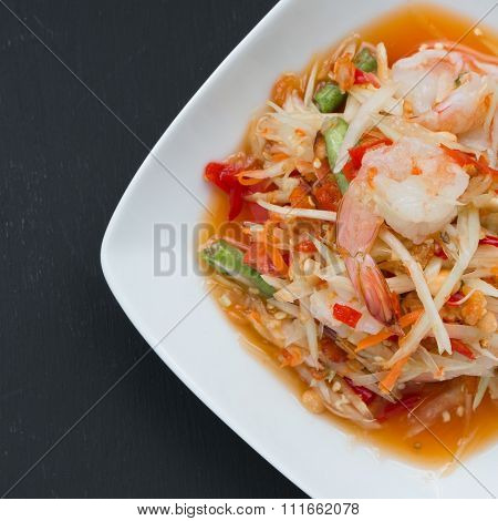 Green Papaya Salad (som Tum) With Shrimp On Black Background