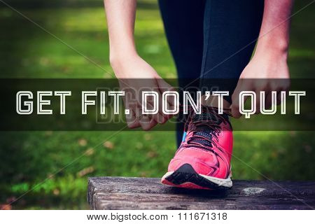 Motivational new years message against young woman tying the shoelaces of her running shoes