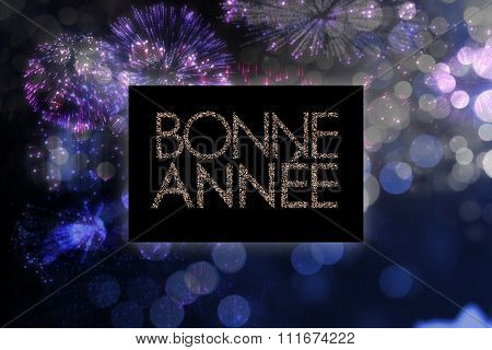 Glittering bonne annee against colourful fireworks exploding on black background