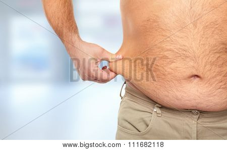 Senior man with big fat stomach. Obesity concept.