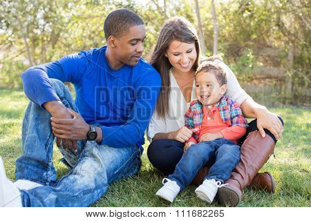 Multi cultural family together at the park