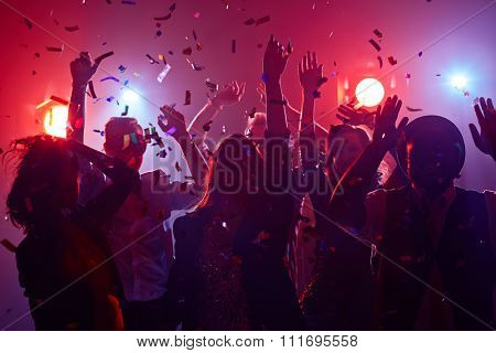 Young people dancing in night club