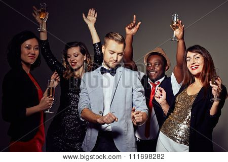 Smart clubbers with champagne having night party