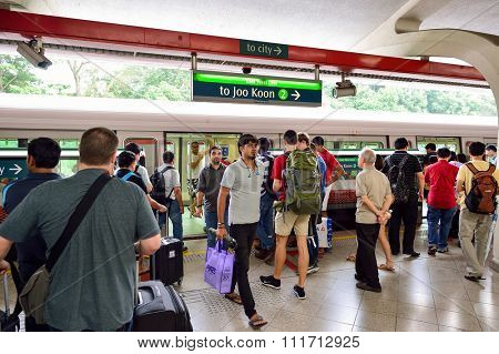 SINGAPORE - NOVEMBER 07, 2015: passengers at MRT station. The Mass Rapid Transit, or MRT, is a rapid transit system forming the major component of the railway system in Singapore.