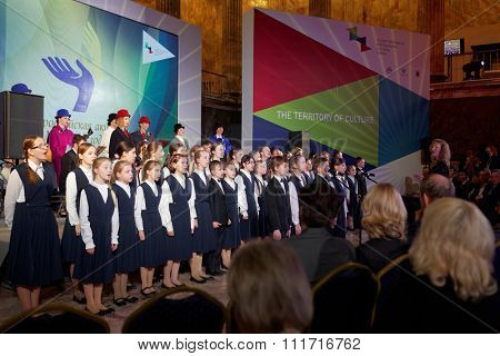 ST. PETERSBURG, RUSSIA - DECEMBER 14, 2015: Children's choir preform during the award ceremony Philanthropist of the Year at the 4th St. Petersburg International Cultural Forum