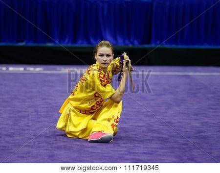 JAKARTA, INDONESIA - NOVEMBER 17, 2015:Liudmyla Temna of Ukraine performs the movements in the women's Jianshu event at the 13th World Wushu Championship 2015 in Istora Senayan Stadium.