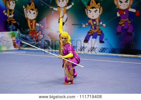 JAKARTA, INDONESIA - NOVEMBER 17, 2015: Hanieh Rajabi of Iran performs the movements in the women's Gunshu event at the 13th World Wushu Championship 2015 in Istora Senayan Stadium.