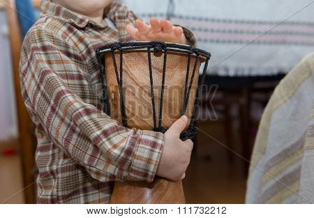 Small Child Playing On Drum