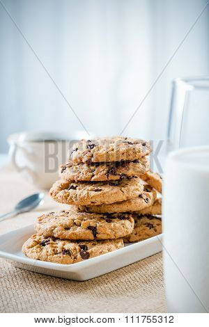 cookies, glass of milk and tea/coffee