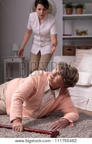 Carer Helping Injured Elderly Woman