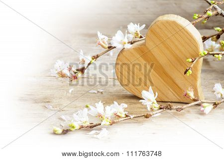 Wooden Heart With Blooming Cherry Branches On A Rustic Wood, Love Symbol For Valentine's Day Or Moth