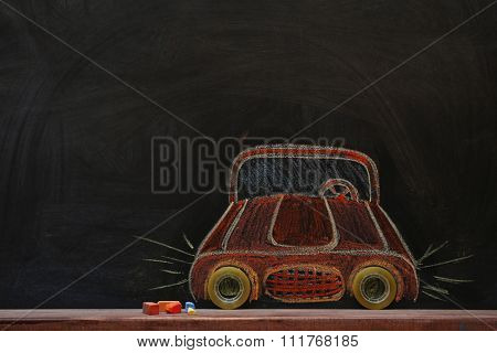 Concept of car with scotch tape and chalk on black background