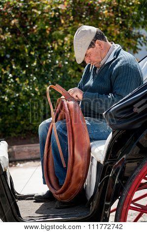 Man repairing a horse collar