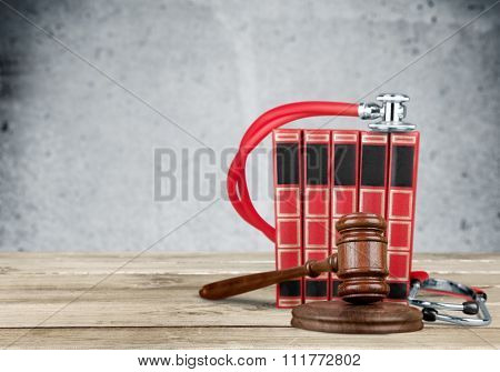 Gavel and stethoscope  on background, symbol photo for bungling and medical error