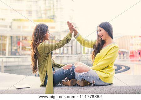Two Women Giving High Five