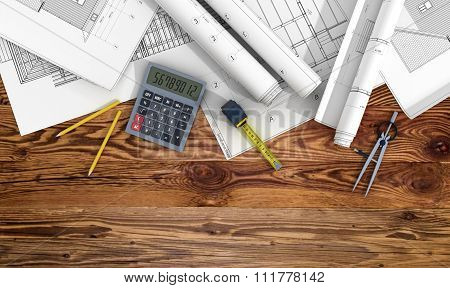 Concept Of Construction And Design. 3D Render Of Blueprints Designer Tools On Wood Background.