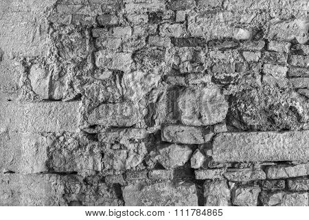 Old Bumpy Texture Of The Destroyed Stone Brick Wall