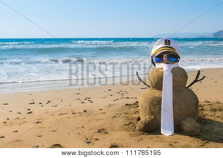 Holidays Snowman Captain made of sand