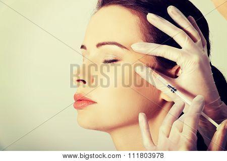 Portrait of woman having cosmetic botox injection.