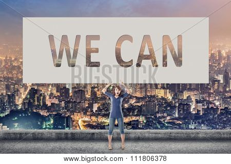 We can, words on blank board hold by a young girl in the outdoor.