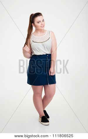 Full length portrait of a casual fat woman standing isolated on a white background