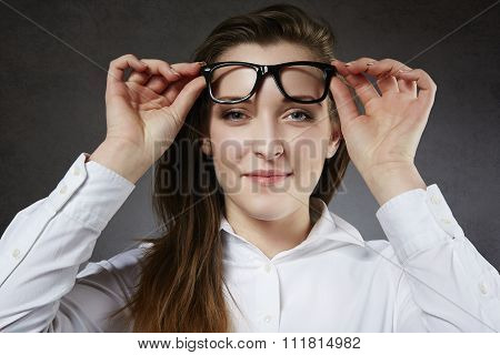 Young Woman put glasses on