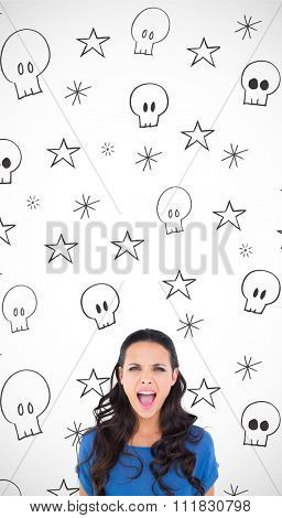 Angry brunette shouting at camera against swearing doodles