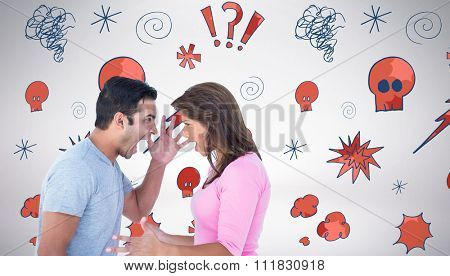 Angry couple shouting during argument against grey background