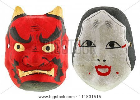 Traditional Japanese theater masks Red devil mask Oni (Demon) and okame otafuku mask, isolated on white