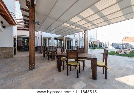 Wooden Table And Chairs On Open Terrace