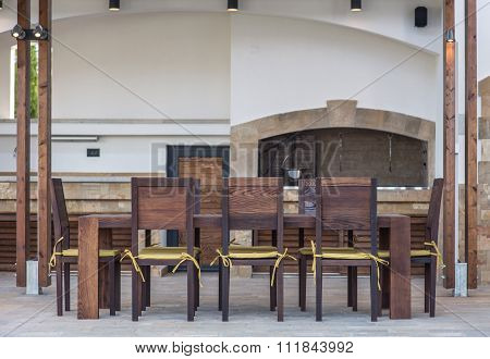 Long Table And Chairs On Veranda