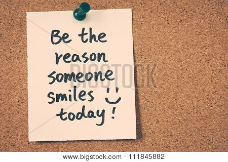 be the reason someone smiles today note pinned on the bulletin board poster