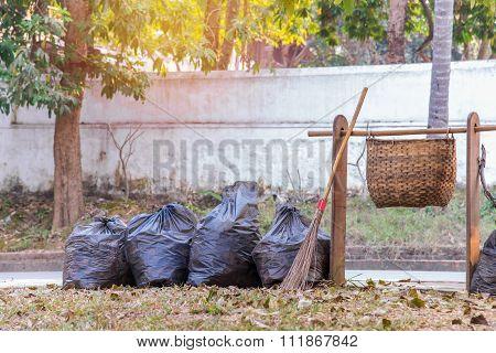 Garbage Bags And Bin On The Sidewalk