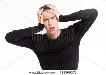 Portrait of a stressed man touching his head isolated on a white background