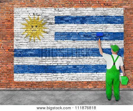 House Painter Paints Flag Of Uruguay