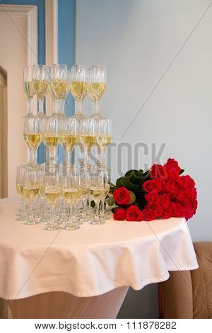 Glasses of champaigne and a bunch of roses
