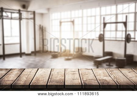 Wooden table against gym