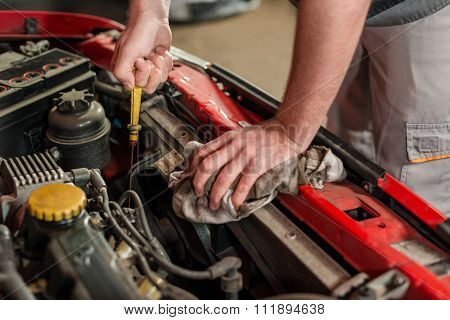 Checking for engine oil on a car