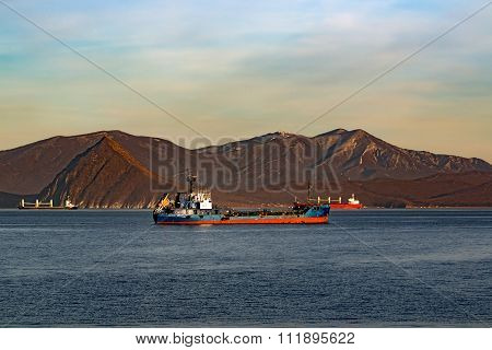 tanker mountains in the background