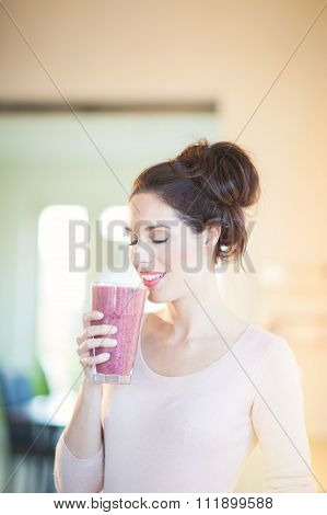 Drinking Fresh Berry Smoothie