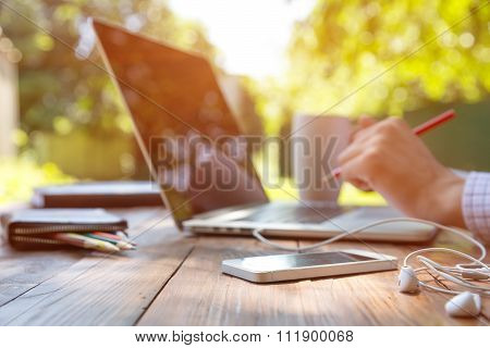 Freelance work Casual dressed man sitting at wooden desk