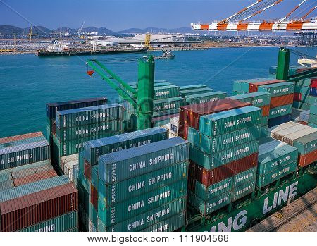 Containers on ship in port