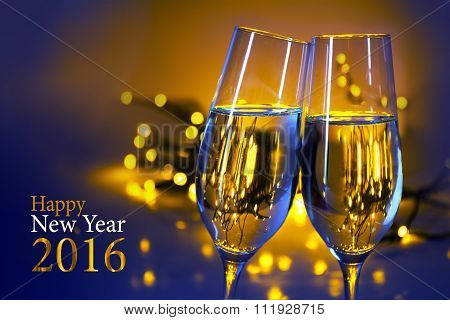 Two Champagne Flutes Against Blue Yellow Background, Text Happy New Year 2016