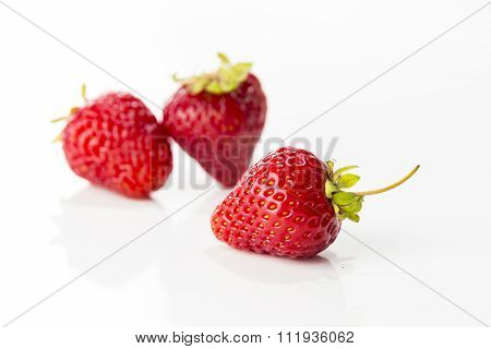 Fresh Strawberry Closeup On White Background