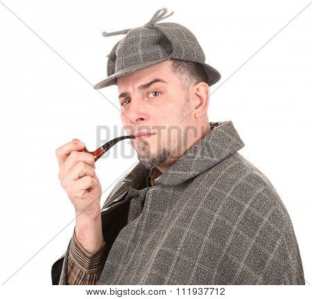 Detective Sherlock Holmes portrait with smoking pipe on white